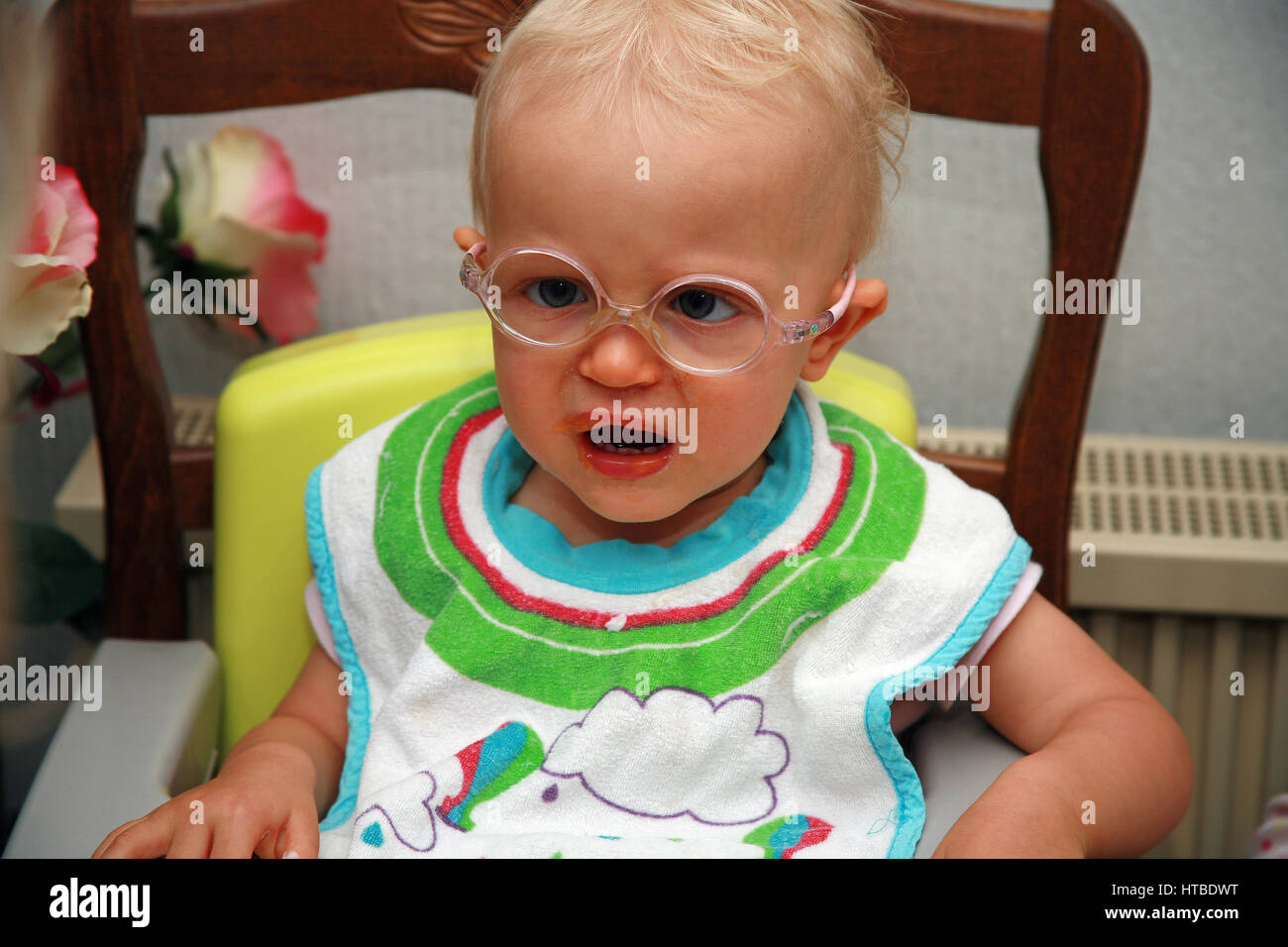 toddler girl with glasses, crying - Stock Image