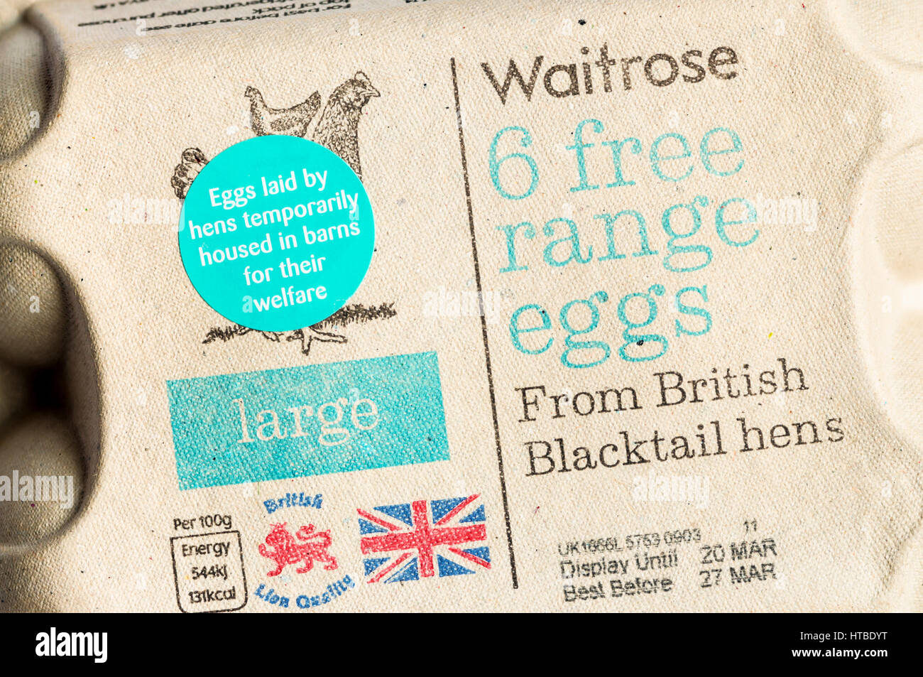 Sticker on egg box says that free range hens are currently kept indoors. Due to a temporary housing order as precaution - Stock Image