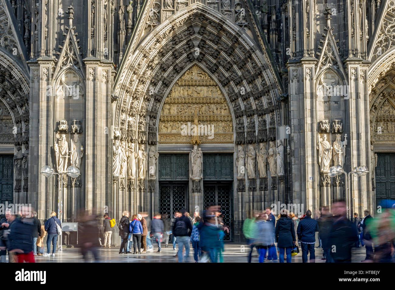 Main entrance Cologne Cathedral, west facade, people in front of the dome, Cologne, North Rhine-Westphalia, Germany - Stock Image