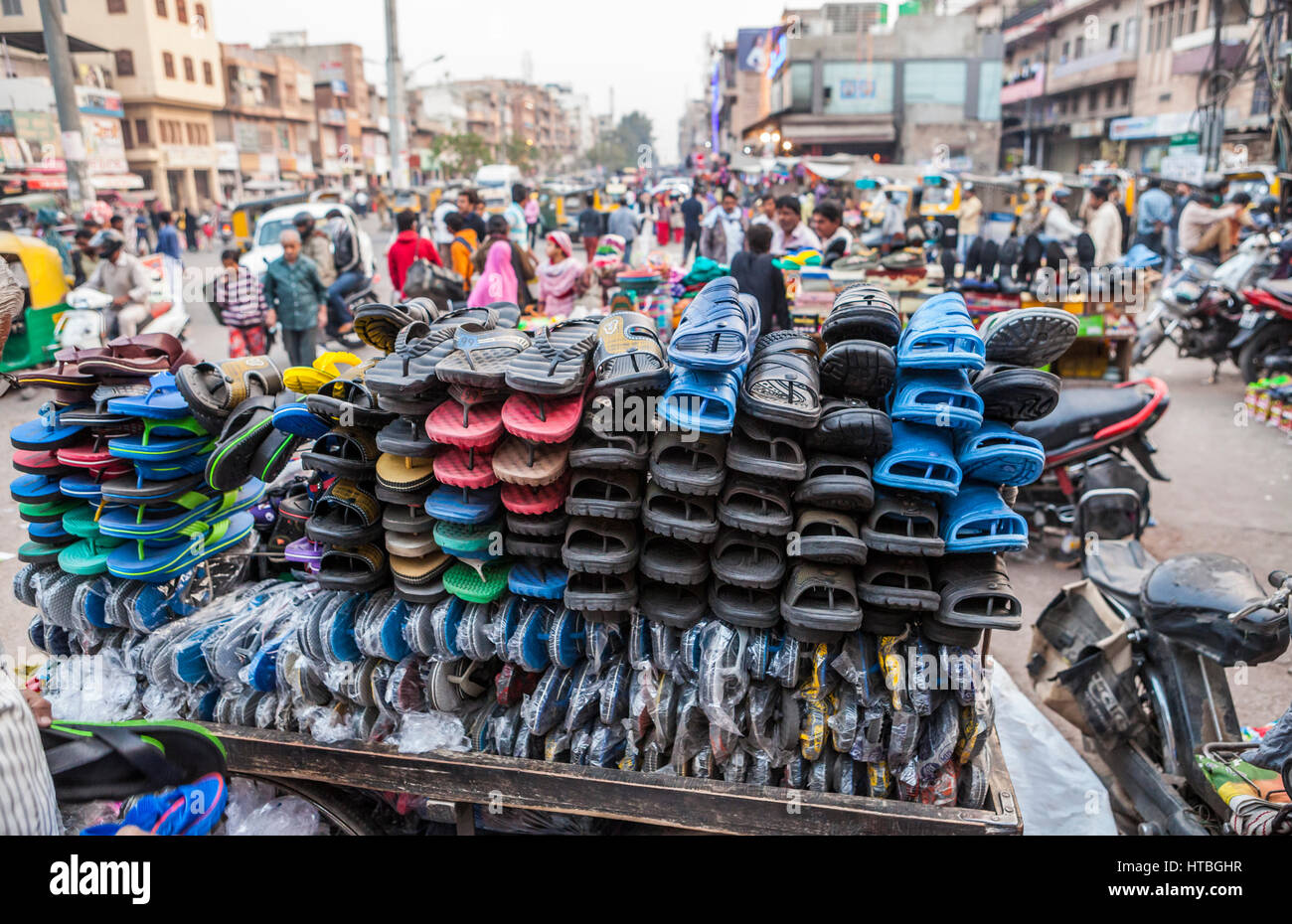 A cart full of sandals and flip flops in Sardar Market, Jodhpur, Rajasthan, India. - Stock Image