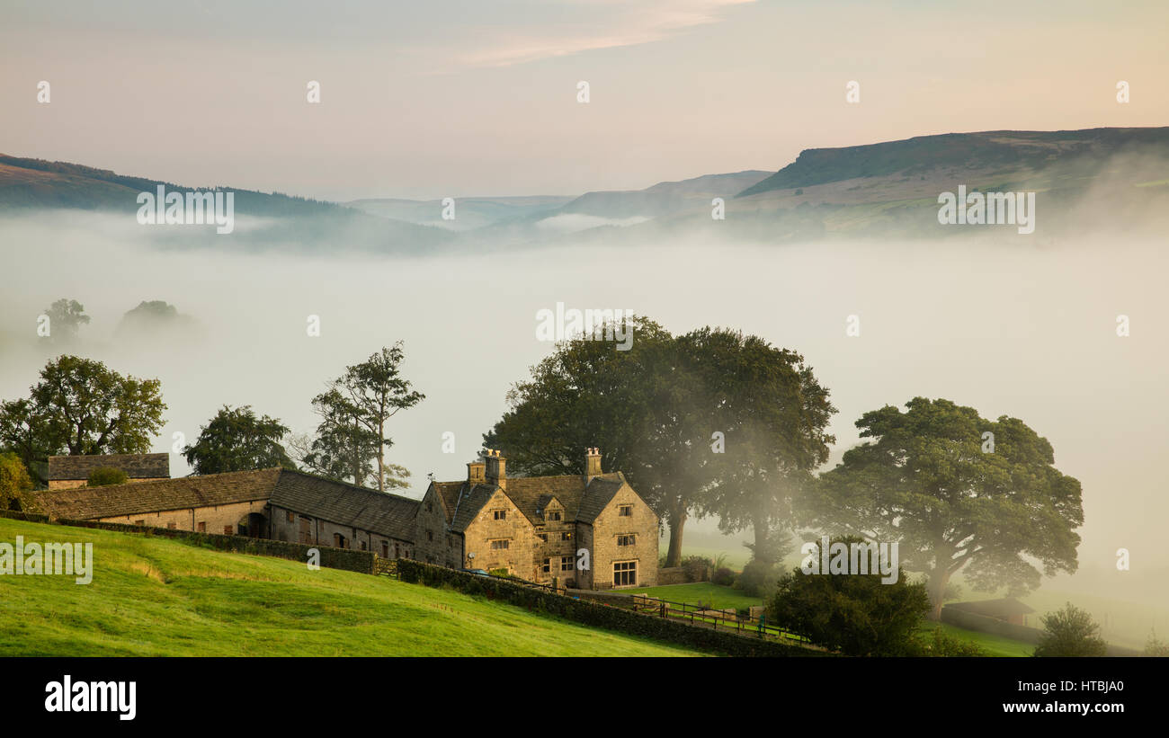 Offerton Hall above the mist in the Derwent Valley below, Derbyshire Peaks District, England, UK - Stock Image