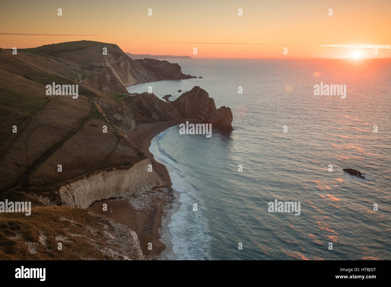 Durdle Door and St Oswald's Bay from Swyre Head at dawn, Purbeck, Jurassic Coast, Dorset, England, UK - Stock Image
