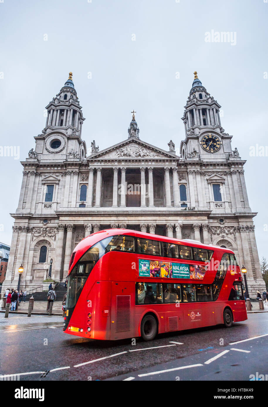 St Paul's Cathedral with double decker bus driving past. London, UK. - Stock Image