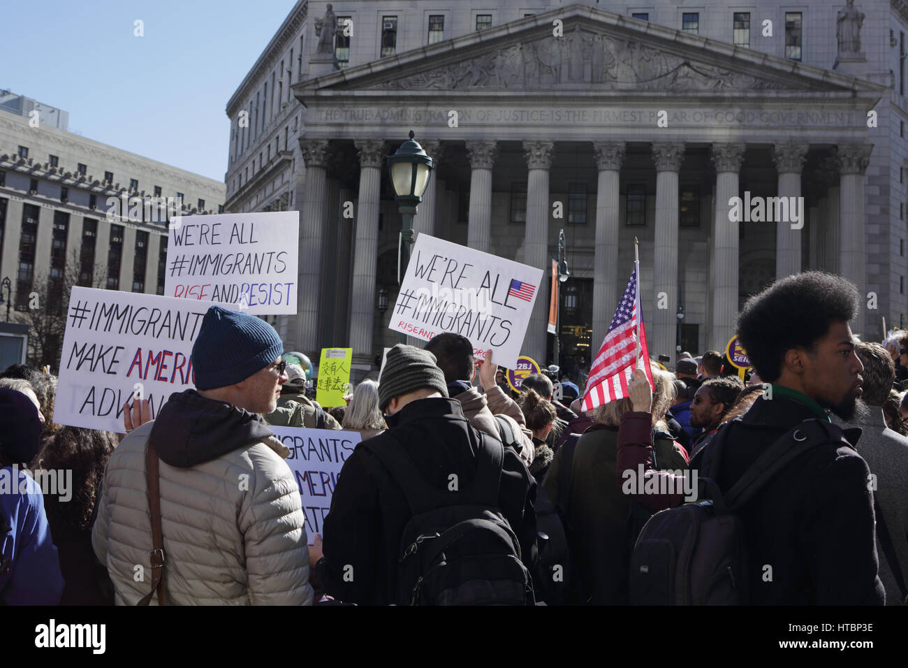 New York, NY, USA - March 9, 2017: A group of about 100 people rally in Foley Square, outside a courthouse in Manhattan, - Stock Image
