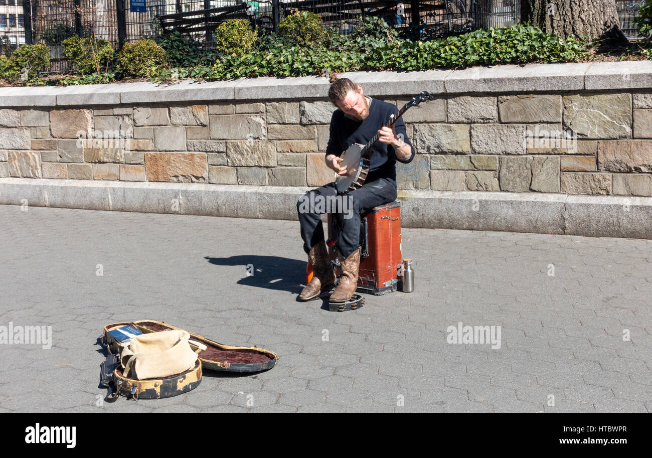 A busker playing the 5-string banjo in Union Square, New York City - Stock Image