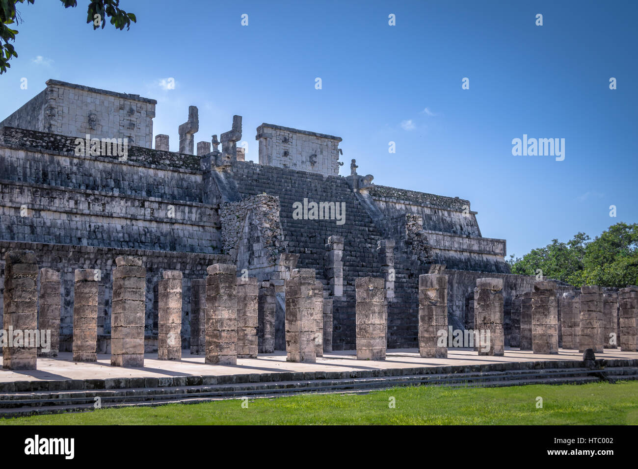Carved columns at Mayan ruins of Temple of the Warriors in Chichen Itza - Yucatan, Mexico - Stock Image