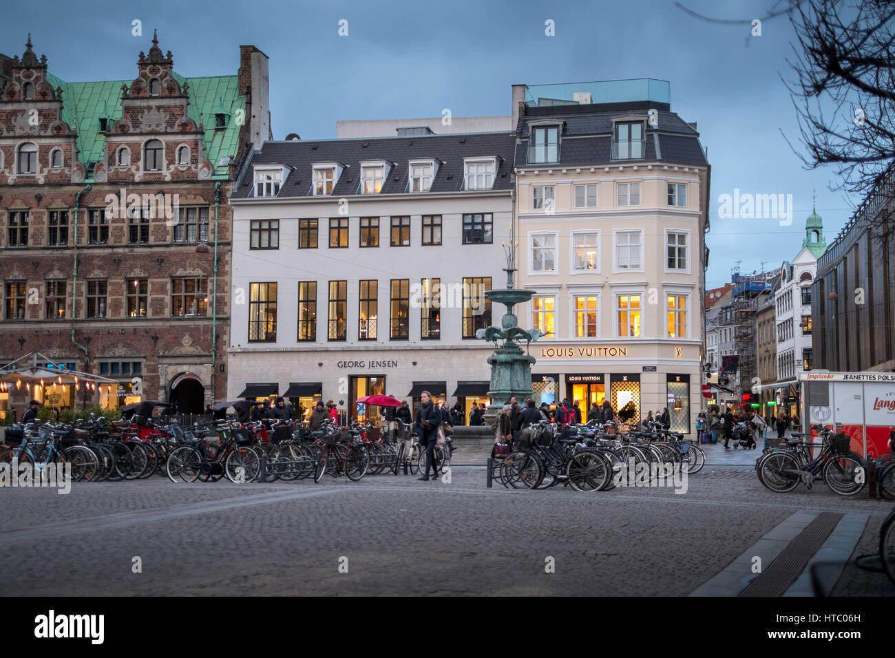 Strøget at dusk by The Stork Fountain, Copenhagen's main shopping street. - Stock Image