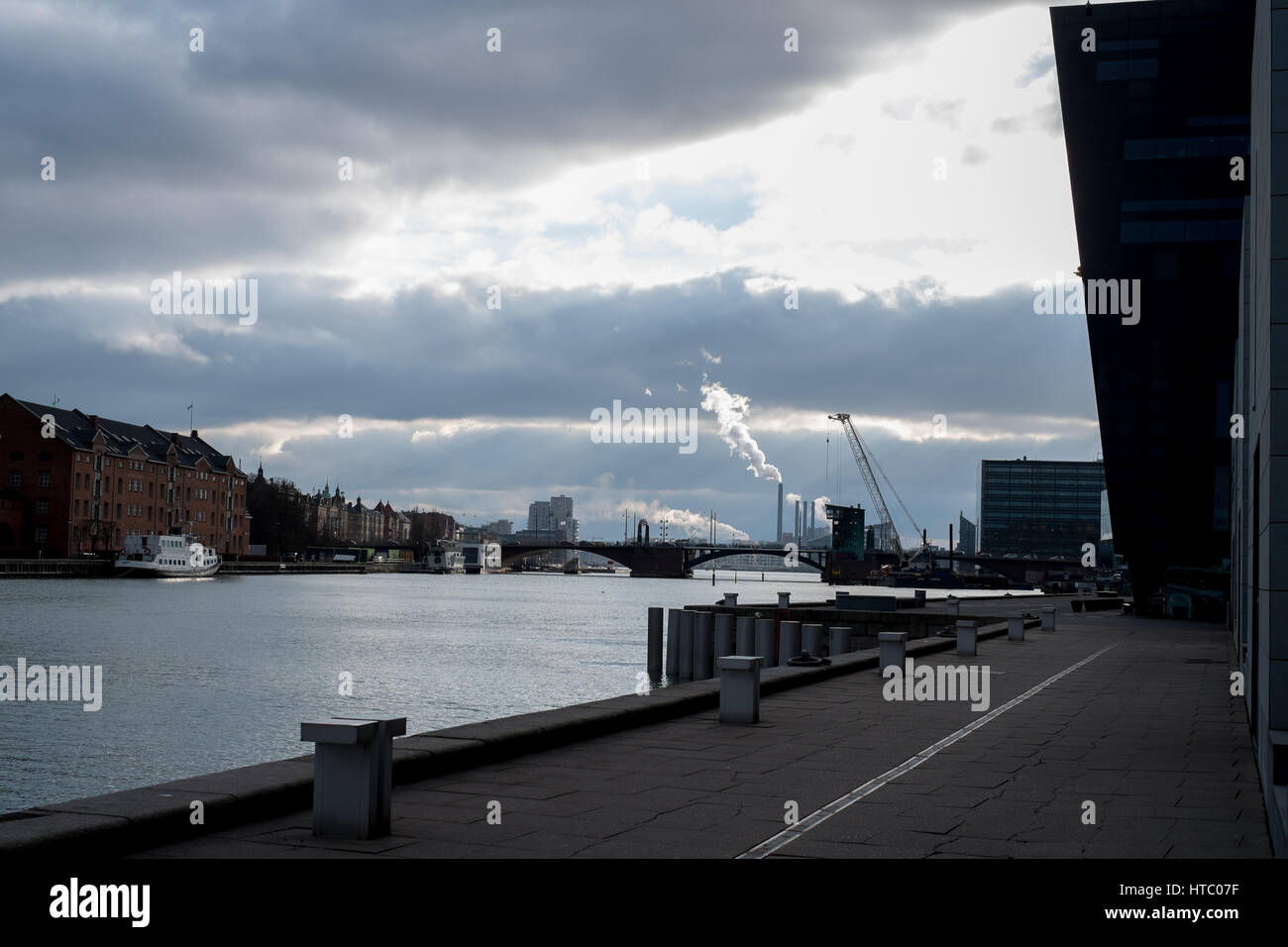 Copenhagen Harbour early evening, sun and clouds by the Royal Danish Library, 'The Black Diamond',  Denmark Stock Photo