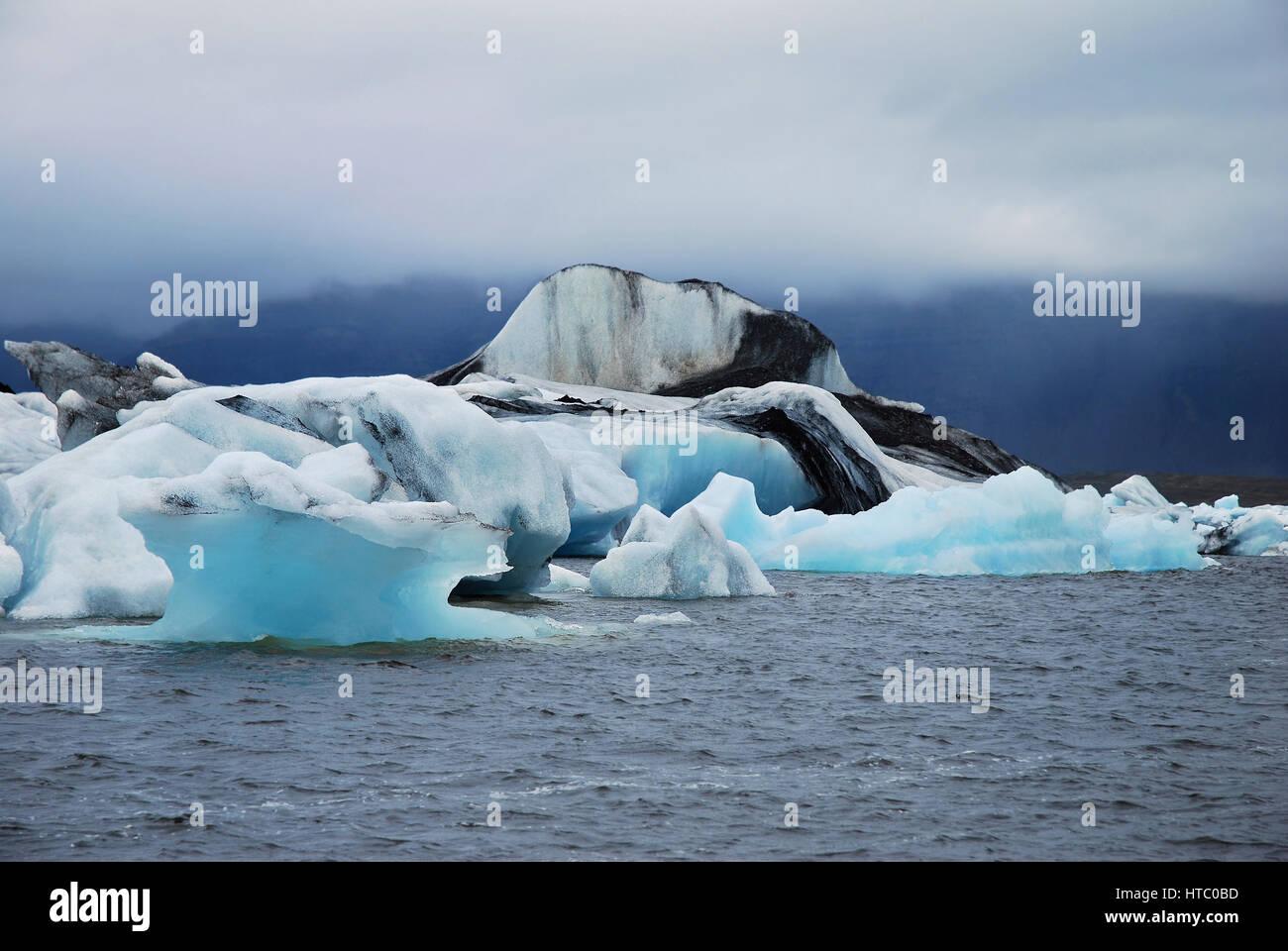 Iceland's Jokulsarlon - glacial lake with blue drifling icebergs on the edge of Vatnajökull National Park, - Stock Image