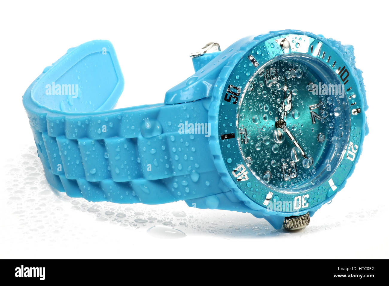 wet blue wristwatch isolated on white background - Stock Image