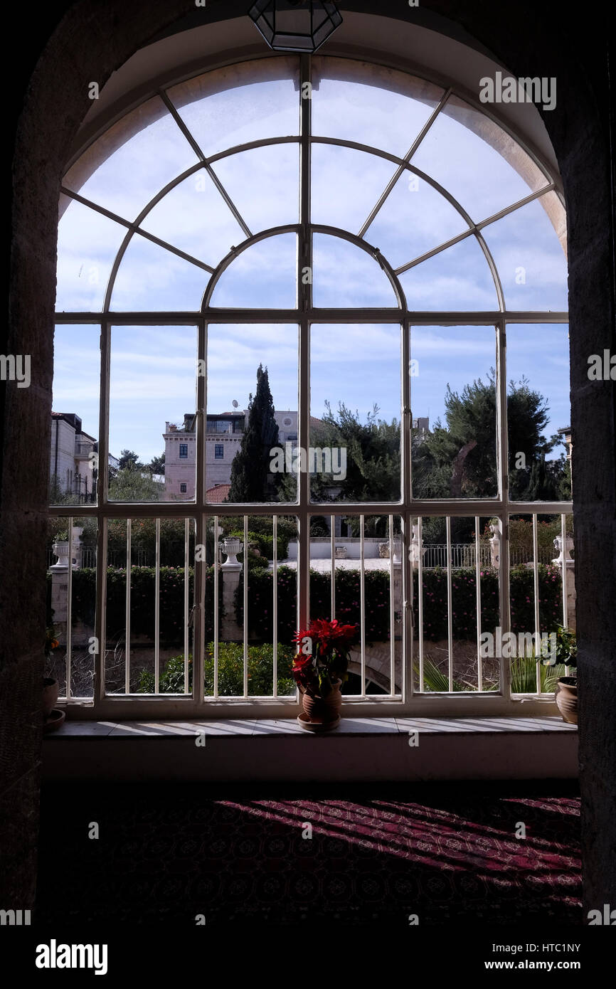 View through an arched window of the American Colony Hotel in East Jerusalem Israel Stock Photo