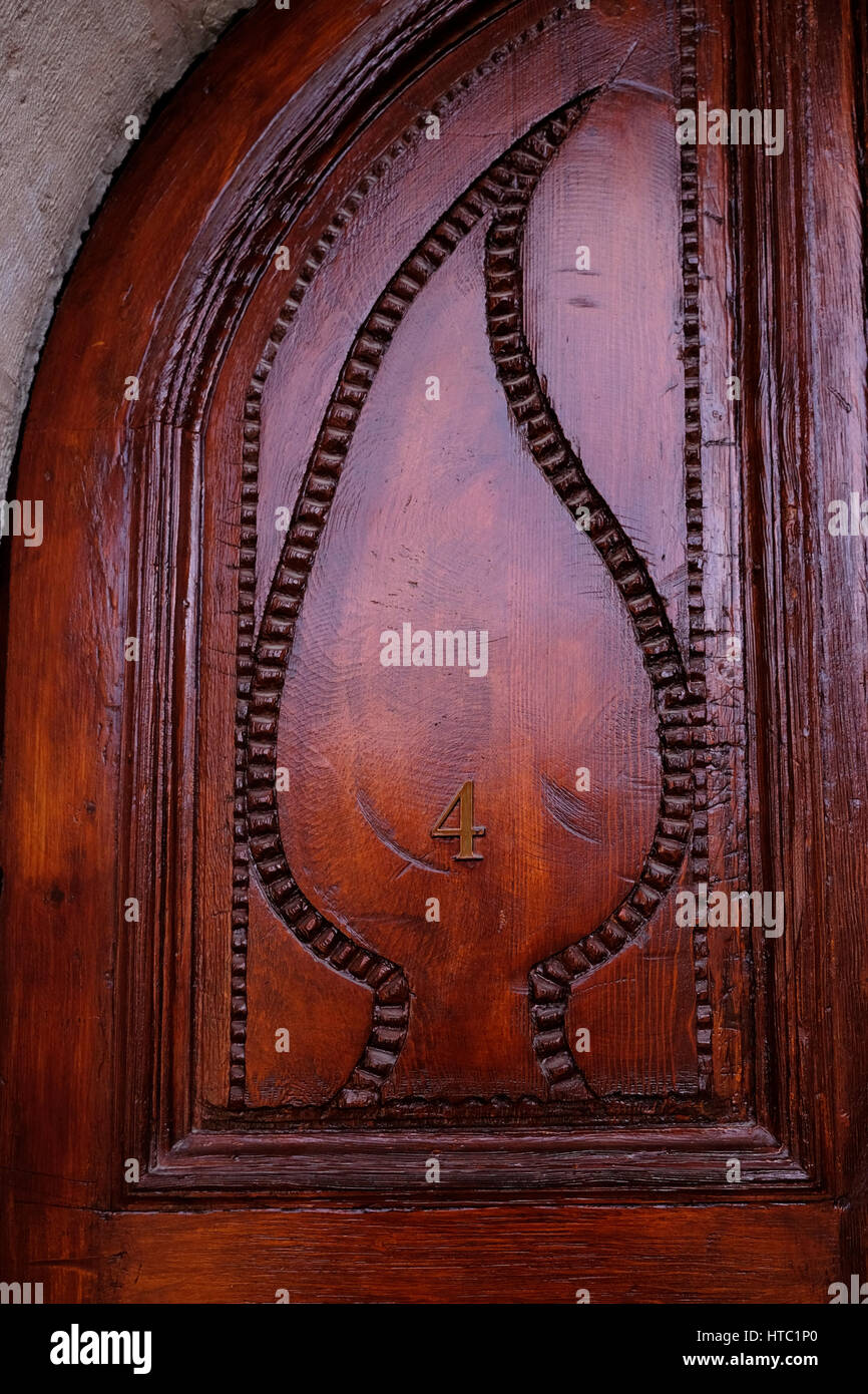 A carved wooden door of room number 4 in the American Colony Hotel in East Jerusalem Israel - Stock Image