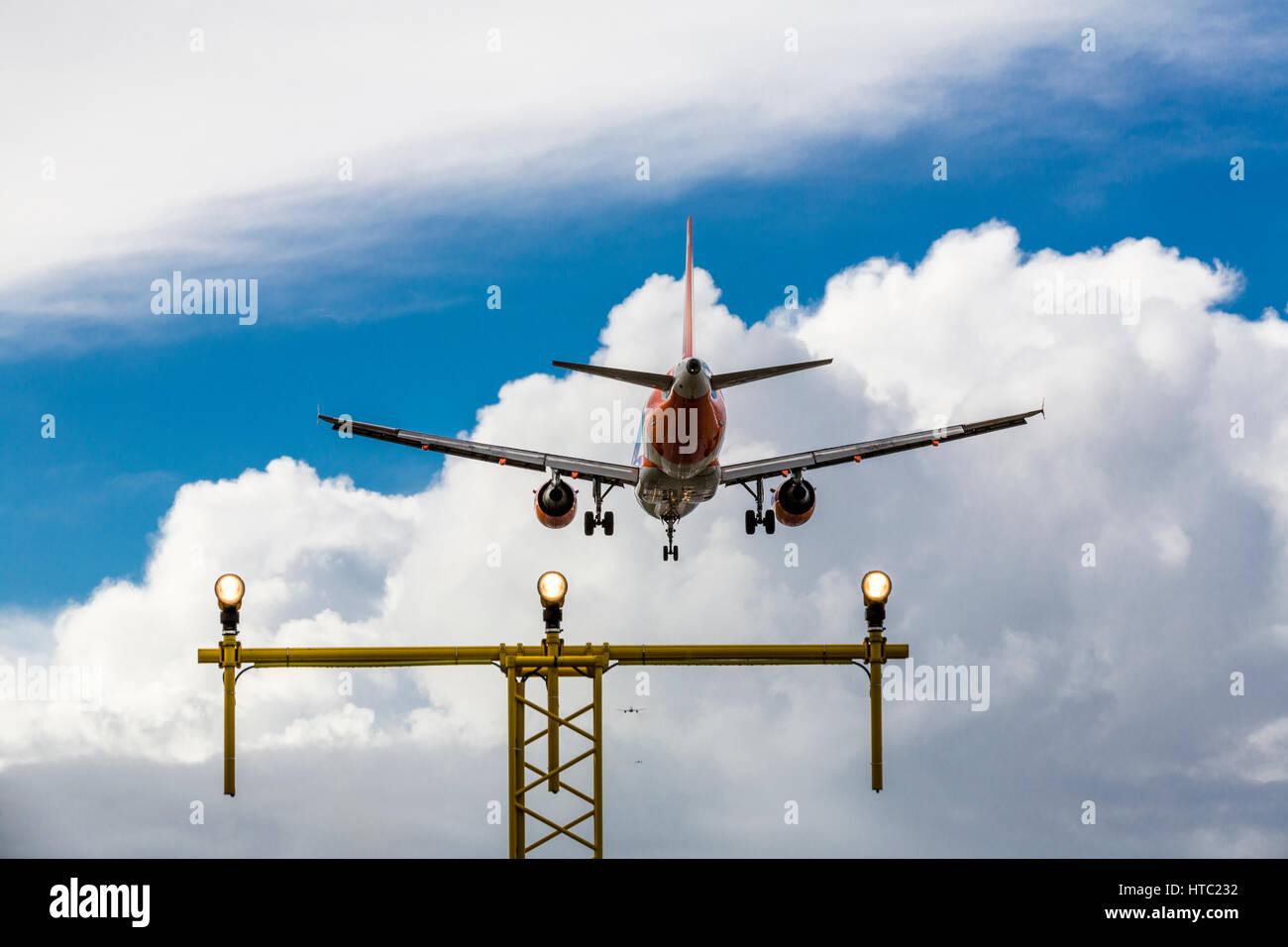 A Jet aircraft landing at a London airport, England UK - Stock Image