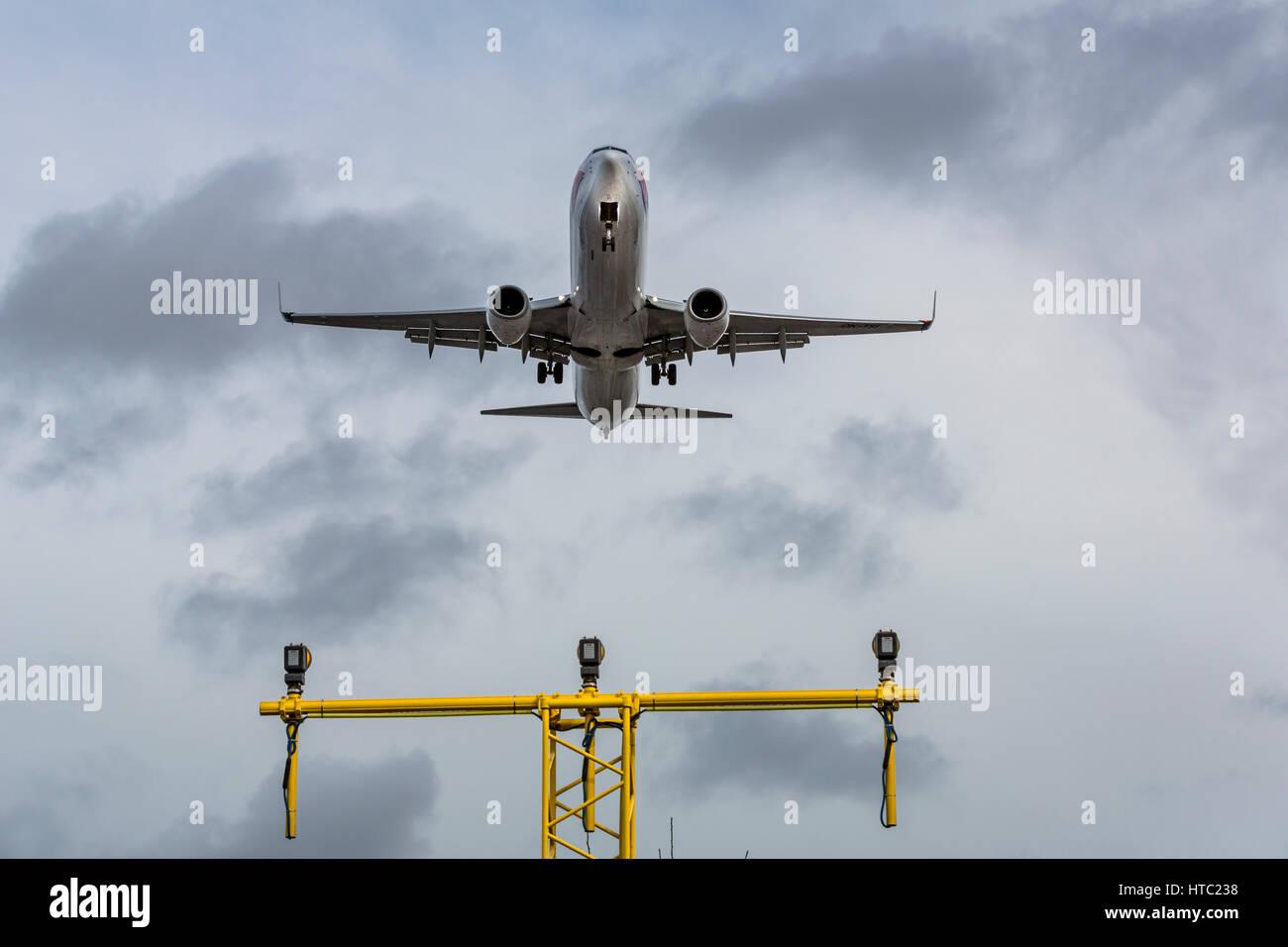 A jet aircraft landing at London Gatwick airport, England UK - Stock Image