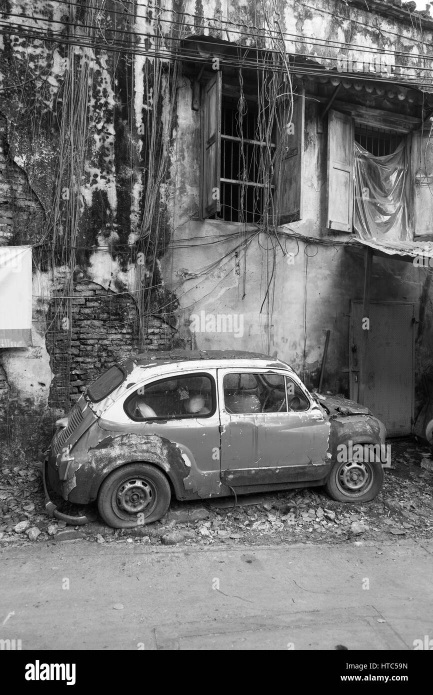 Old beetle car in vintage style. - Stock Image
