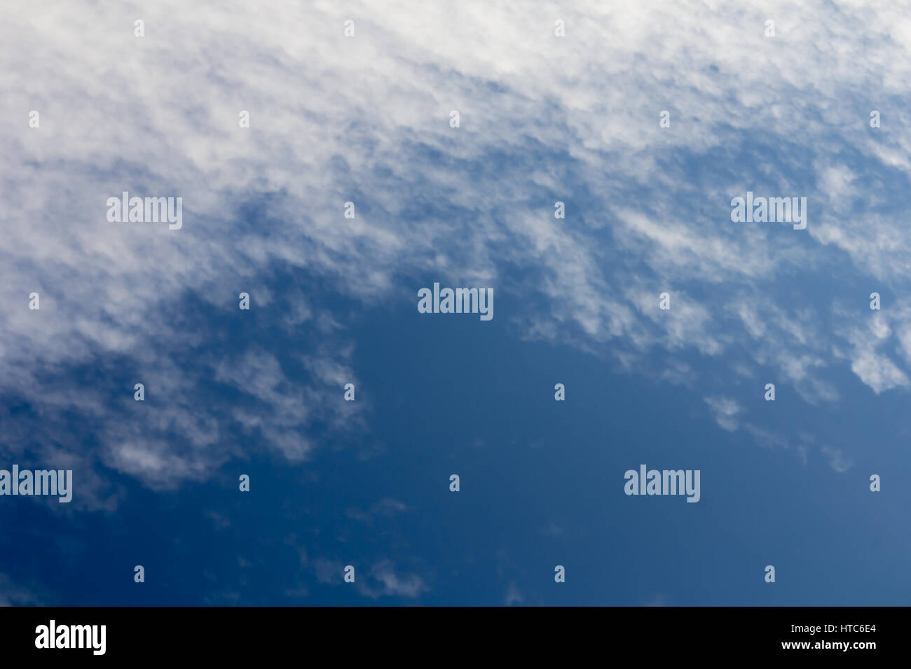 white fluffy clouds in the blue sky - Stock Image