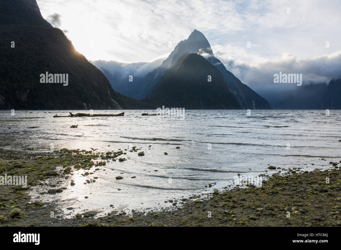 Milford Sound, Fiordland National Park, Southland, New Zealand. View from shoreline to Mitre Peak and the Footstool, - Stock Image
