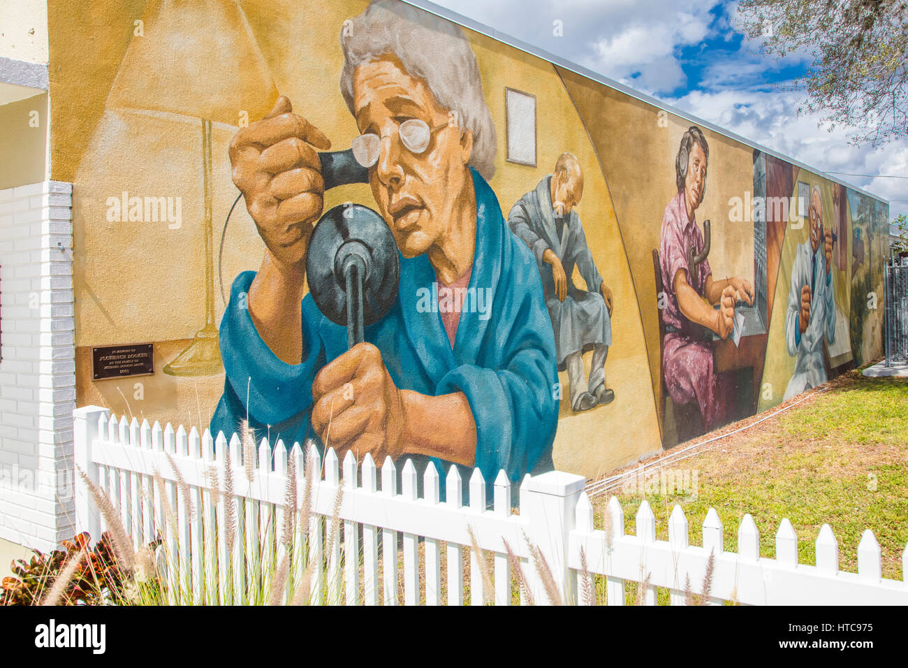 Art murals painted on outdoor building walls in Lake Placid Florida known as the Town of Murals - Stock Image