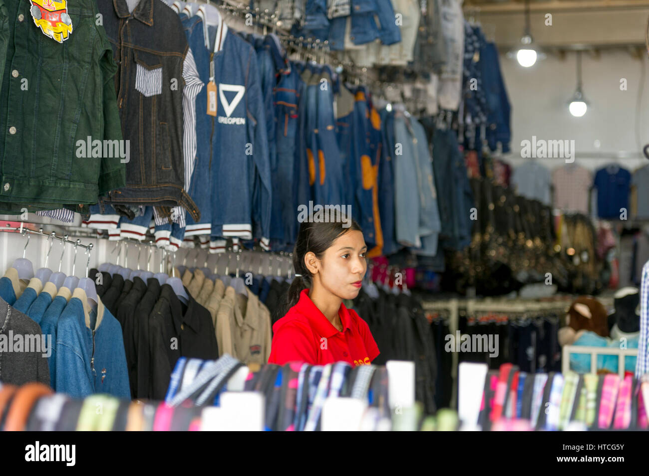 Myanmar (formerly Burma). Mon State. Mawlamyine (Moulmein). Saleswoman in a clothing store - Stock Image