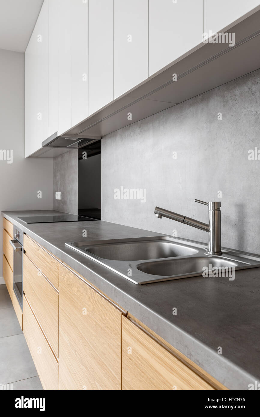 Modern White And Wooden Kitchen Cabinets With Concrete Counter Top