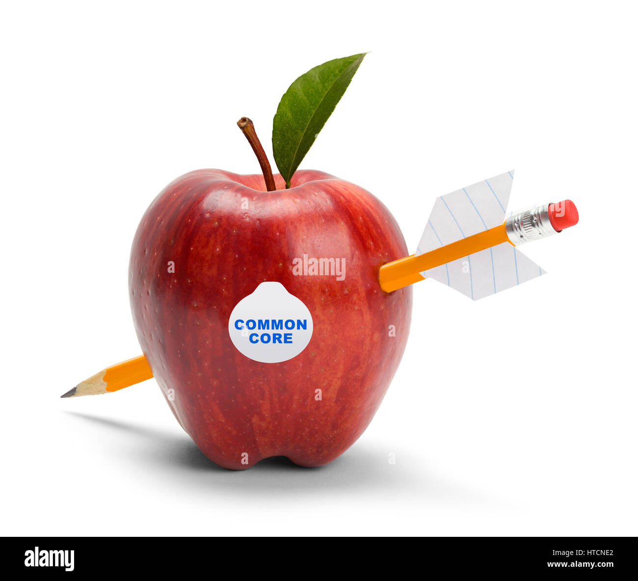 Apple with Common Core Sticker Shot by Pencil Arrow Isolated on White. - Stock Image