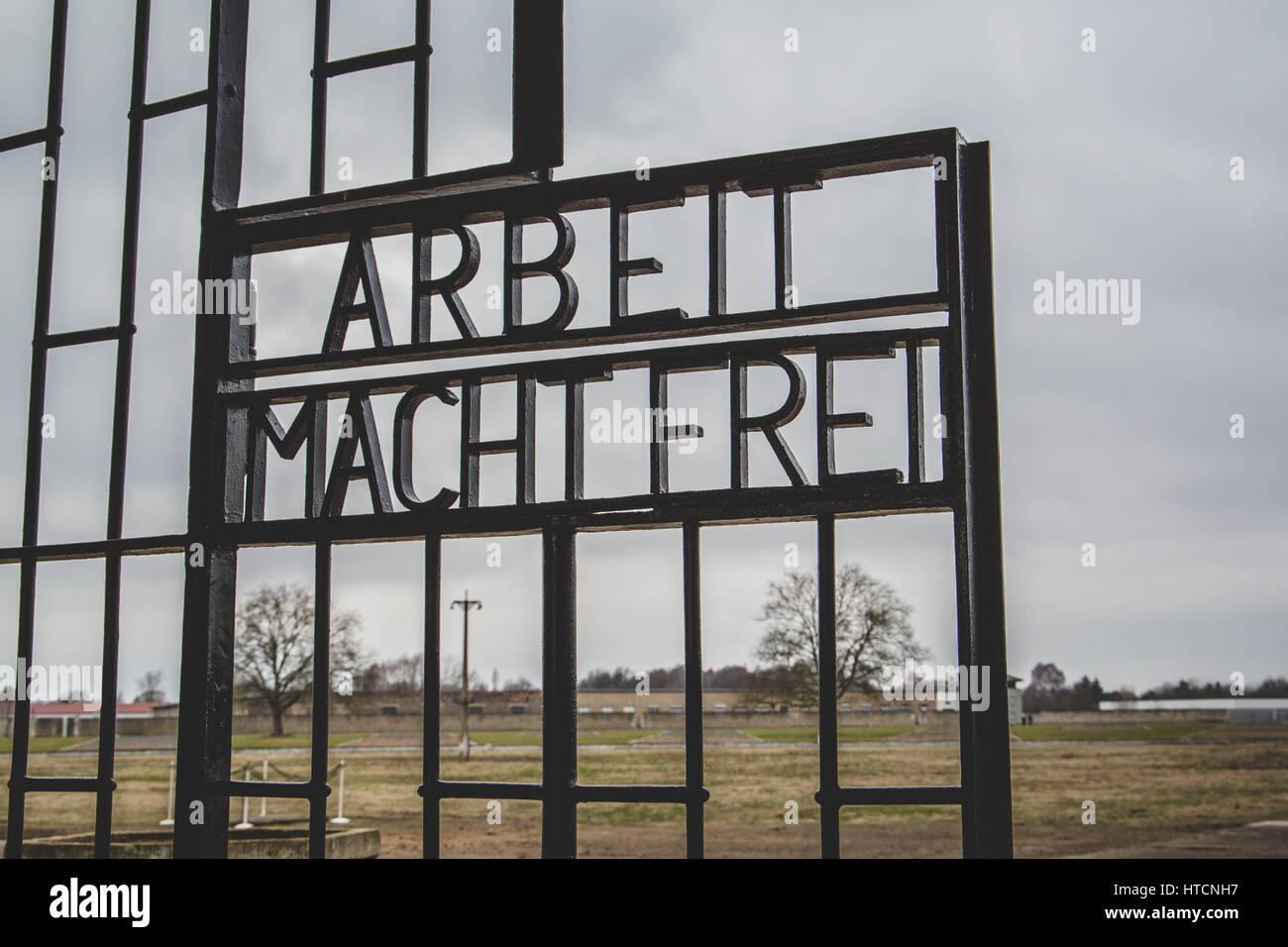 Arbeit Macht Frei gate at Sachsenhausen concentration camp memorial site, Oranienburg, Germany - Stock Image