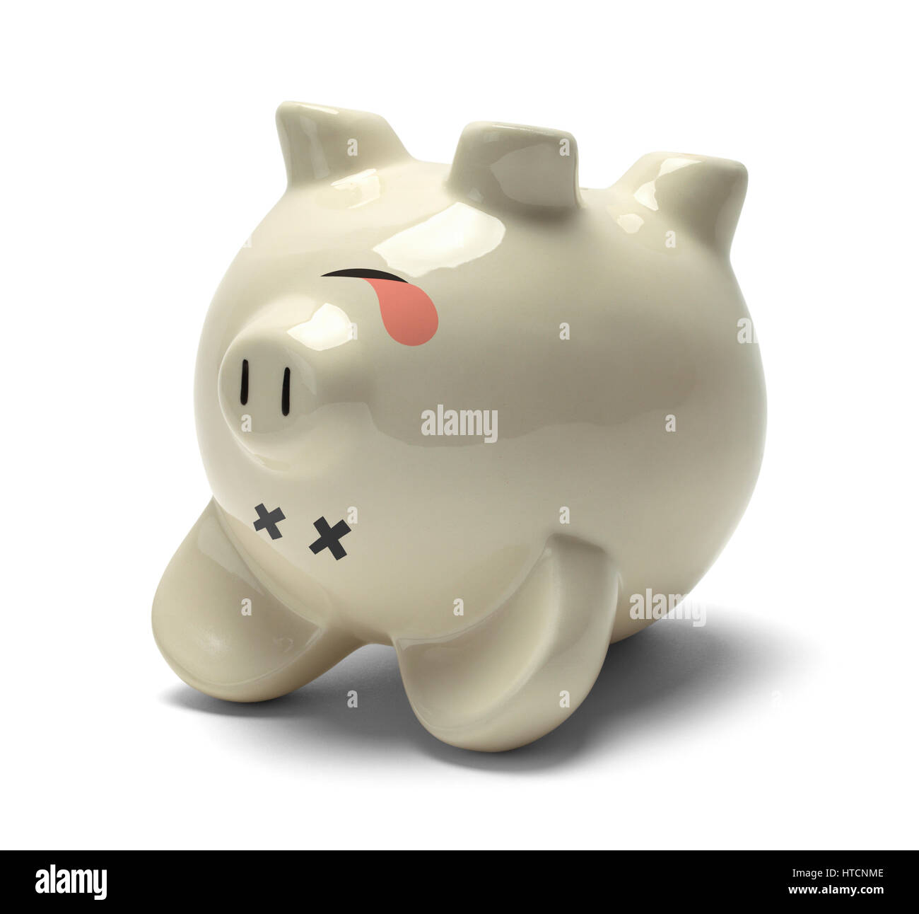 Upside Down Dead Piggy Bank Isolated on White Background. - Stock Image