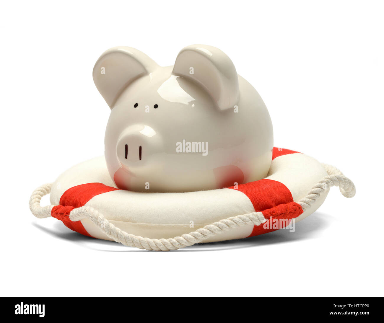 Piggy Bank Saved by a Life Preserver Isolated on White Background. - Stock Image