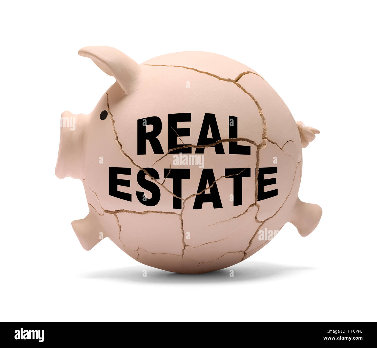 Real Estate Piggy Bank Cracking Apart Isolated on White Background. - Stock Image