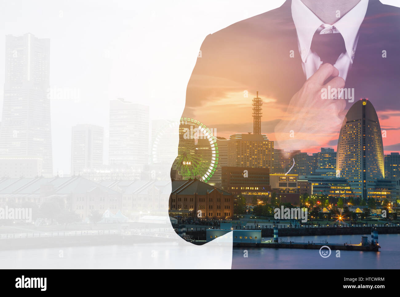 Double exposure of Businessman in suit tying the necktie against the city Stock Photo