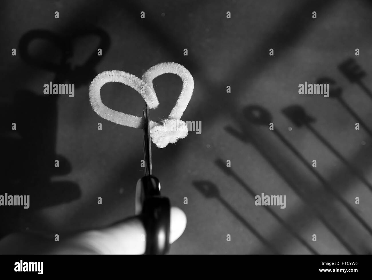 Divorce background with shadow of couple beside divorce letter on paper, separation family make hurt to man and - Stock Image