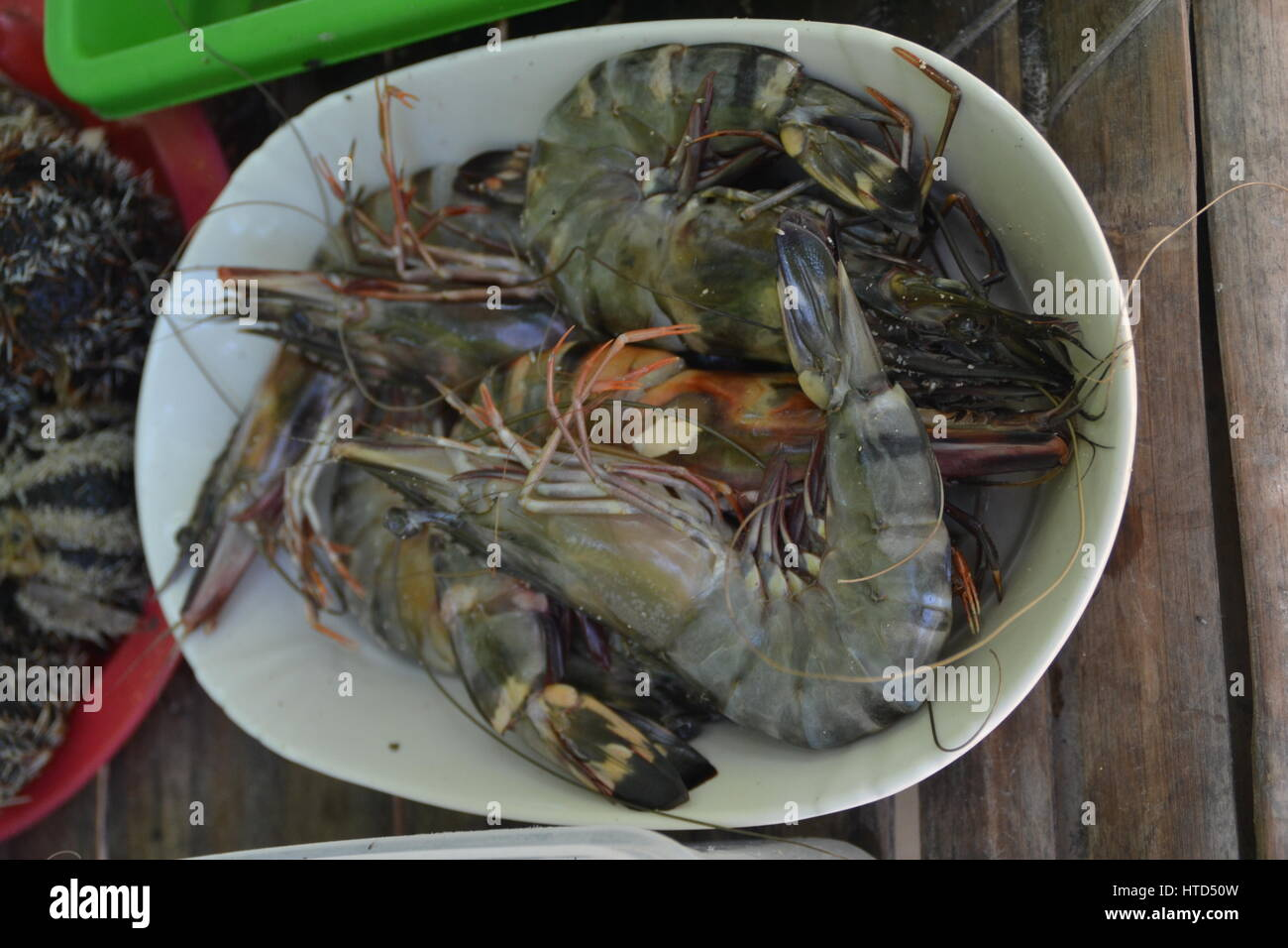 Crabs are prepared and eaten as dish in several different ways. Cooked or grilled. Very tasty, lots of them at square - Stock Image