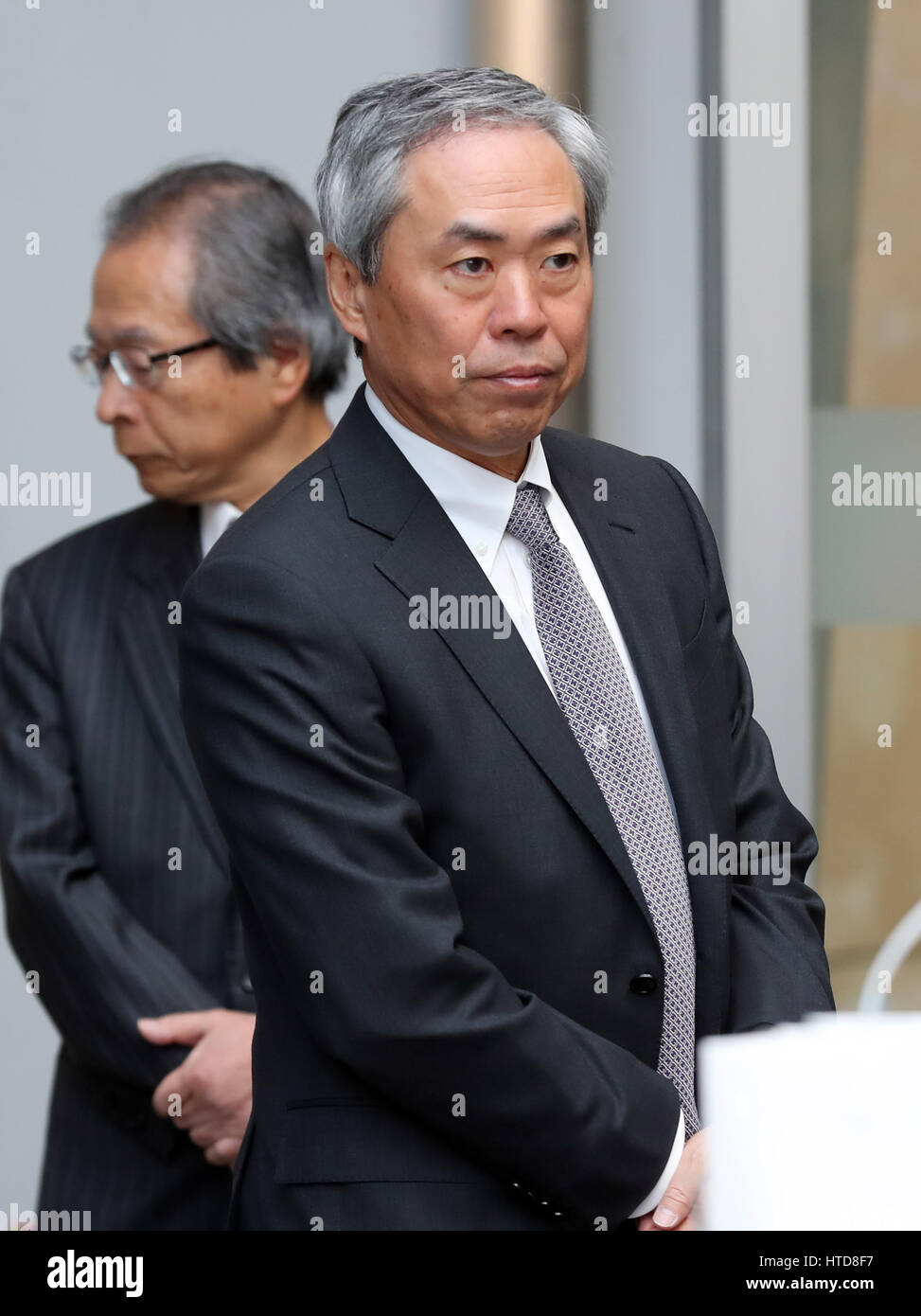 Tokyo, Japan. 10th Mar, 2017. Shingo Tsuji, president of Mori Building participates a disaster drill at the Roppongi Stock Photo