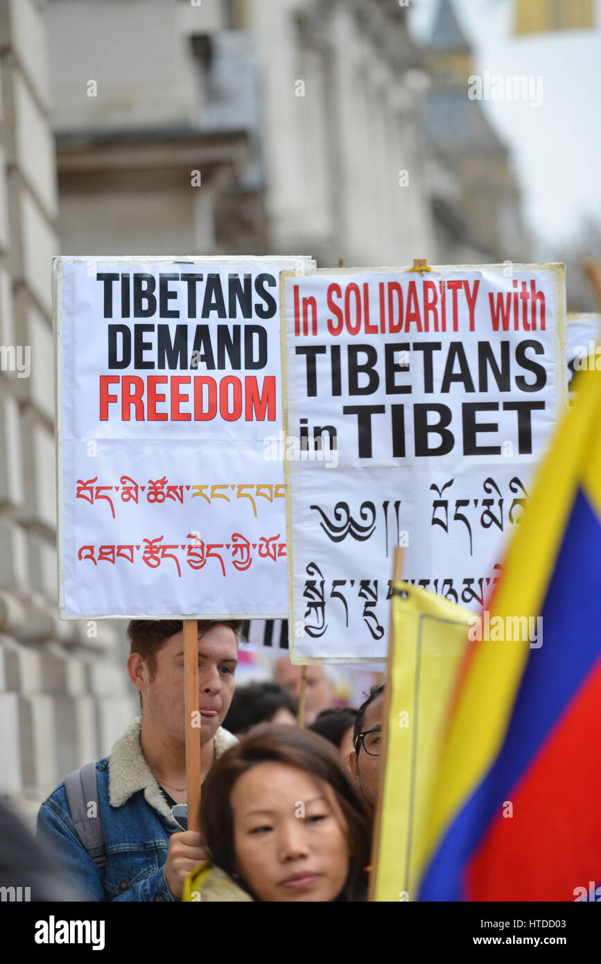 London, UK. 10th March 2017. Tibetans mark the 58th anniversary of the Tibetan uprising, marching from Downing Street - Stock Image