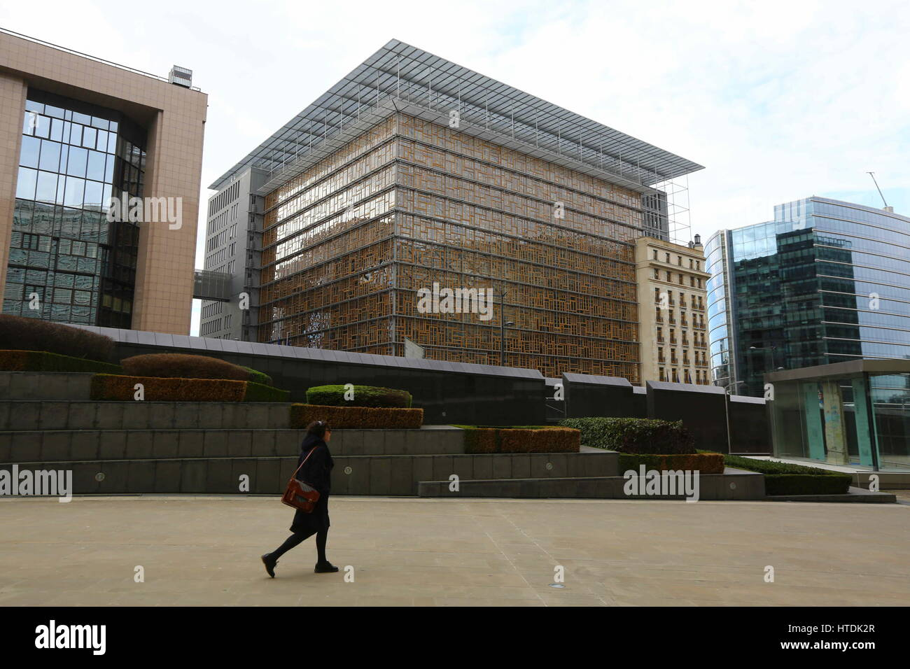 Brussels, Belgium. 10th Mar, 2017. A pedestrian walks by the Europa building in Brussels, Belgium, on March 10, - Stock Image