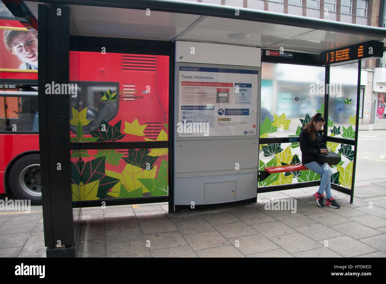 Putney London, UK. 11th Mar, 2017. London first green bus zone is up and running in Putney High Street using low - Stock Image