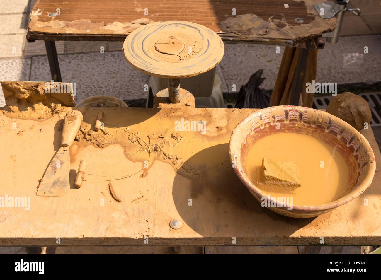 Pottery table on a sunny summer day - Stock Image