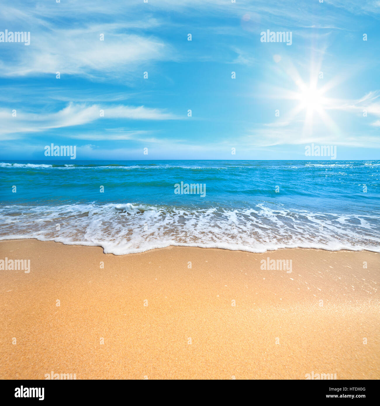 Paradise Sea or Ocean Sunny Beach with gentle  surf of wave and clean yellow sand - Summer concept background - Stock Image