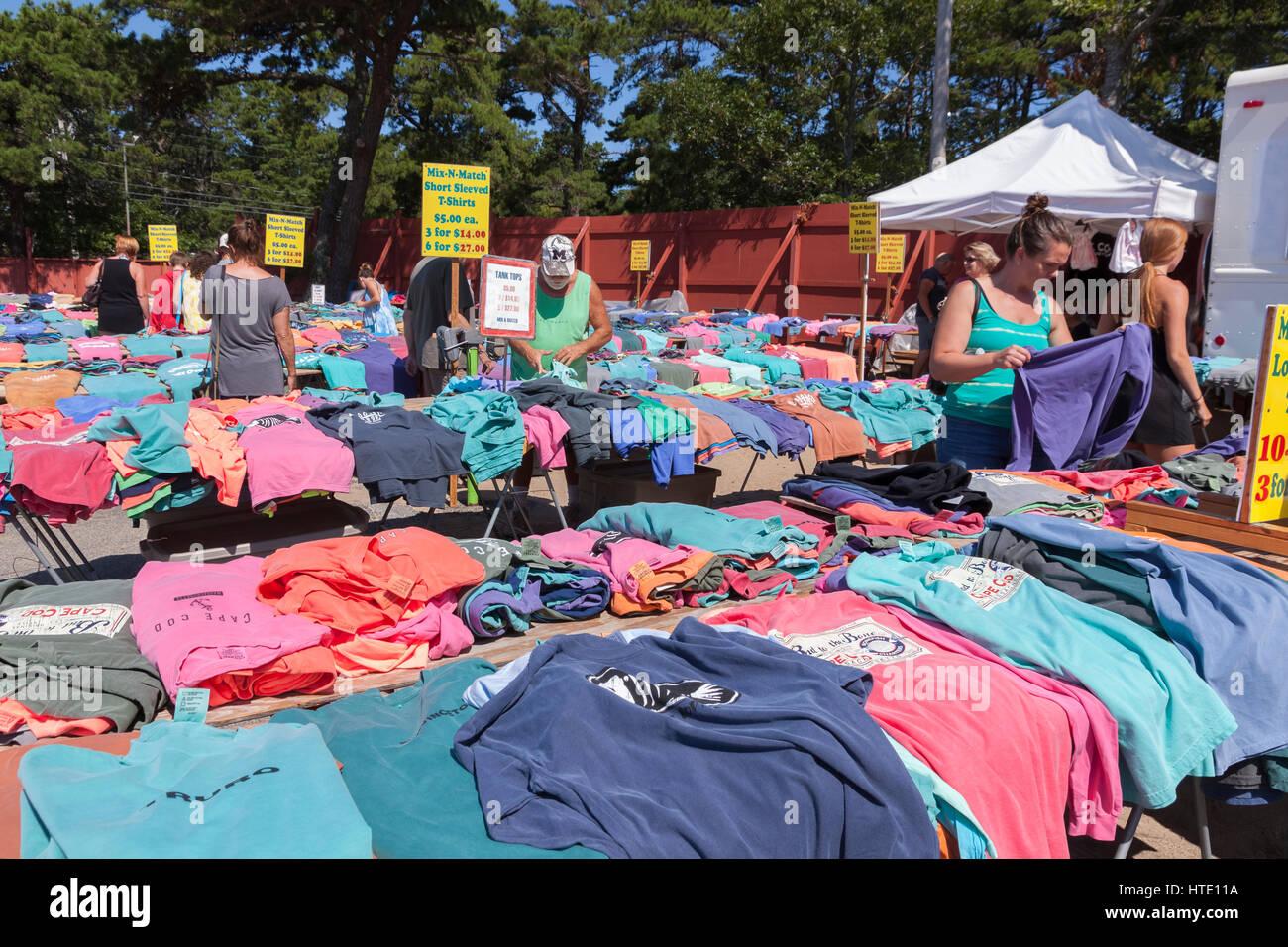 Tee shirts on sale at the Wellfleet Flea Market, Cape Cod, Massachusetts, USA - Stock Image
