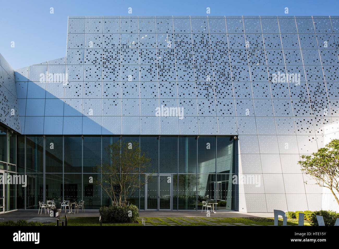 detail of perforated aluminium facade and glazing s233nart