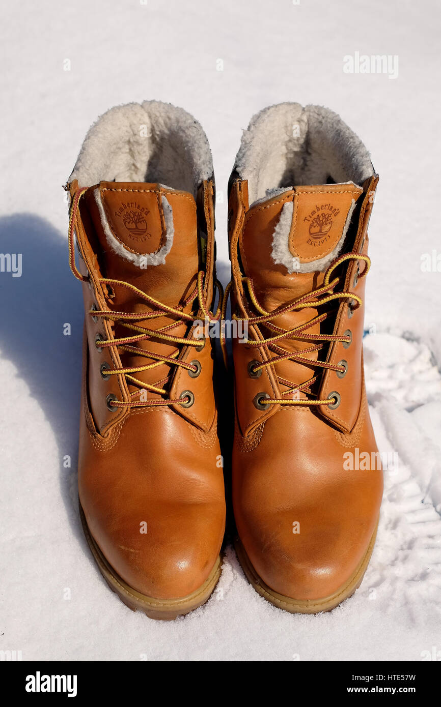 Winter Timberland pair of mens boots Stock Photo: 135535789
