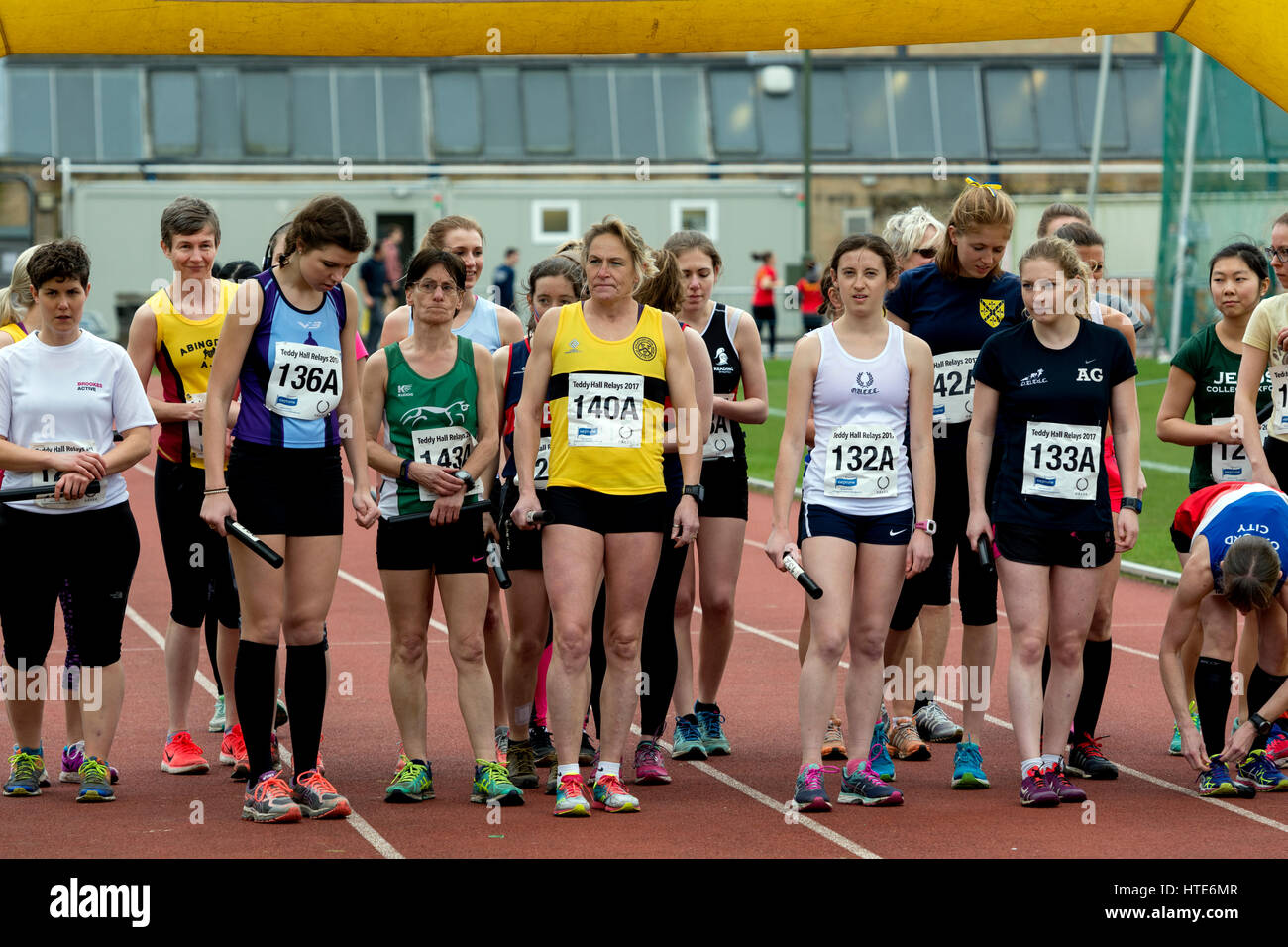 Women runners at Iffley Road track at the start of the Teddy Hall Relays, Oxford, UK - Stock Image
