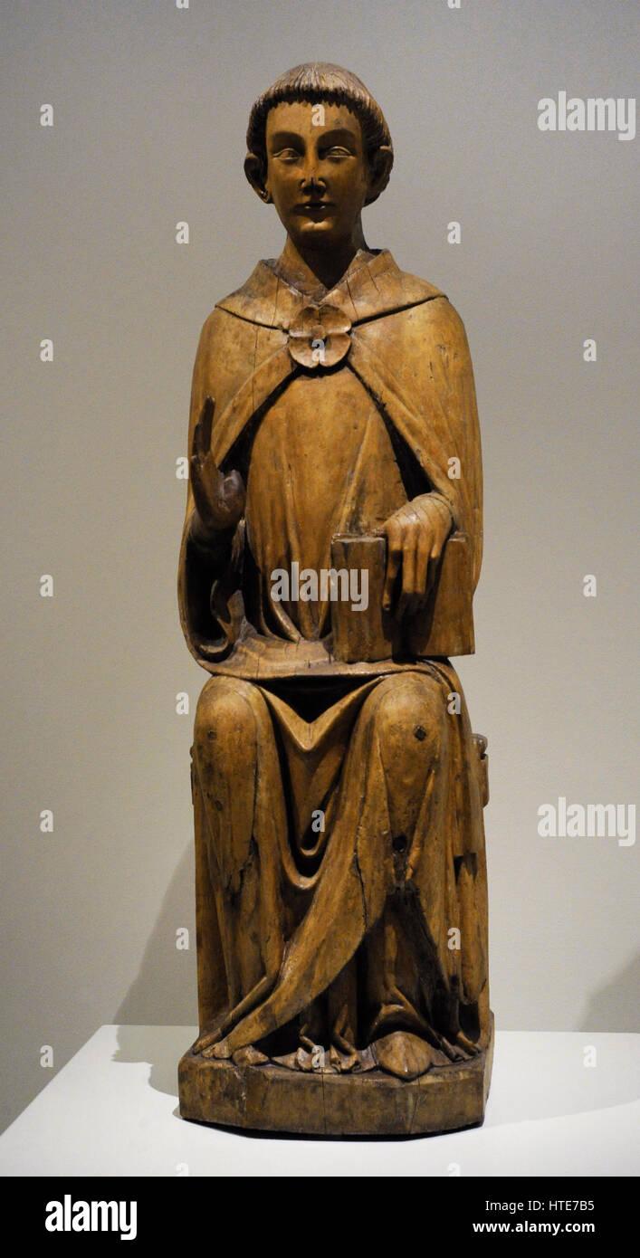Sculpture of a Deacon Saint. Ca.1300. Group of Saint-Bertrand-de-Comminges, France. Gothic style. Birch wood with - Stock Image