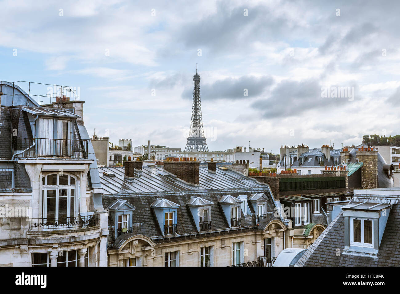 view on eiffel tower from a roof in paris on a grey cloudy day stock photo 135538480 alamy. Black Bedroom Furniture Sets. Home Design Ideas