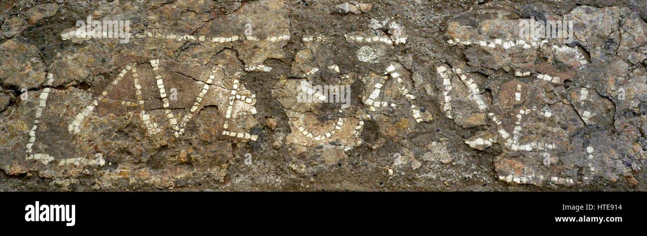 Roman Era. High Empire. Fragment of pavement with welcome inscription. Fragment of a pavement of Opus Signinum with Stock Photo