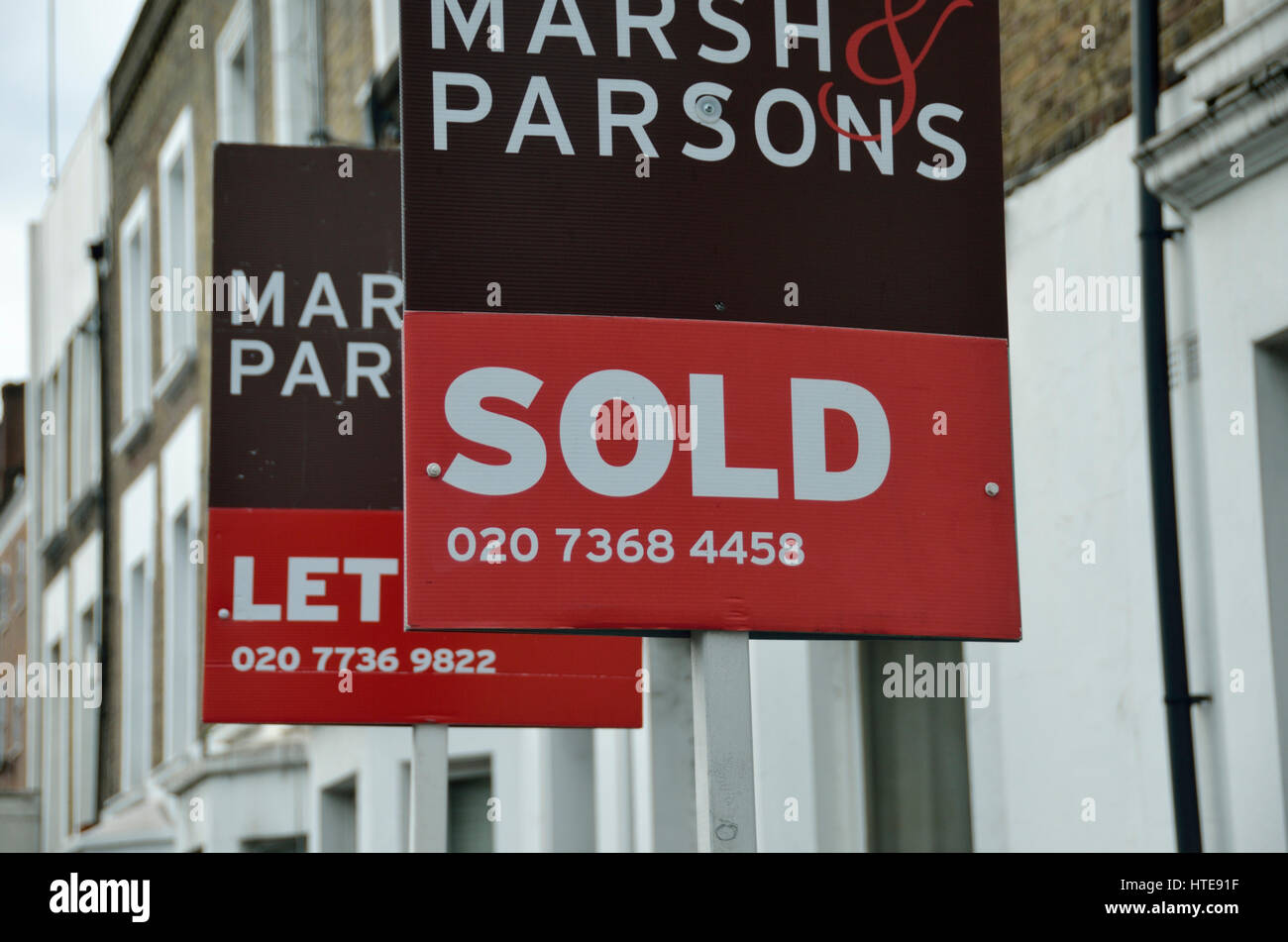 Sold and Let estate agent boards outside residential property, London, UK. - Stock Image
