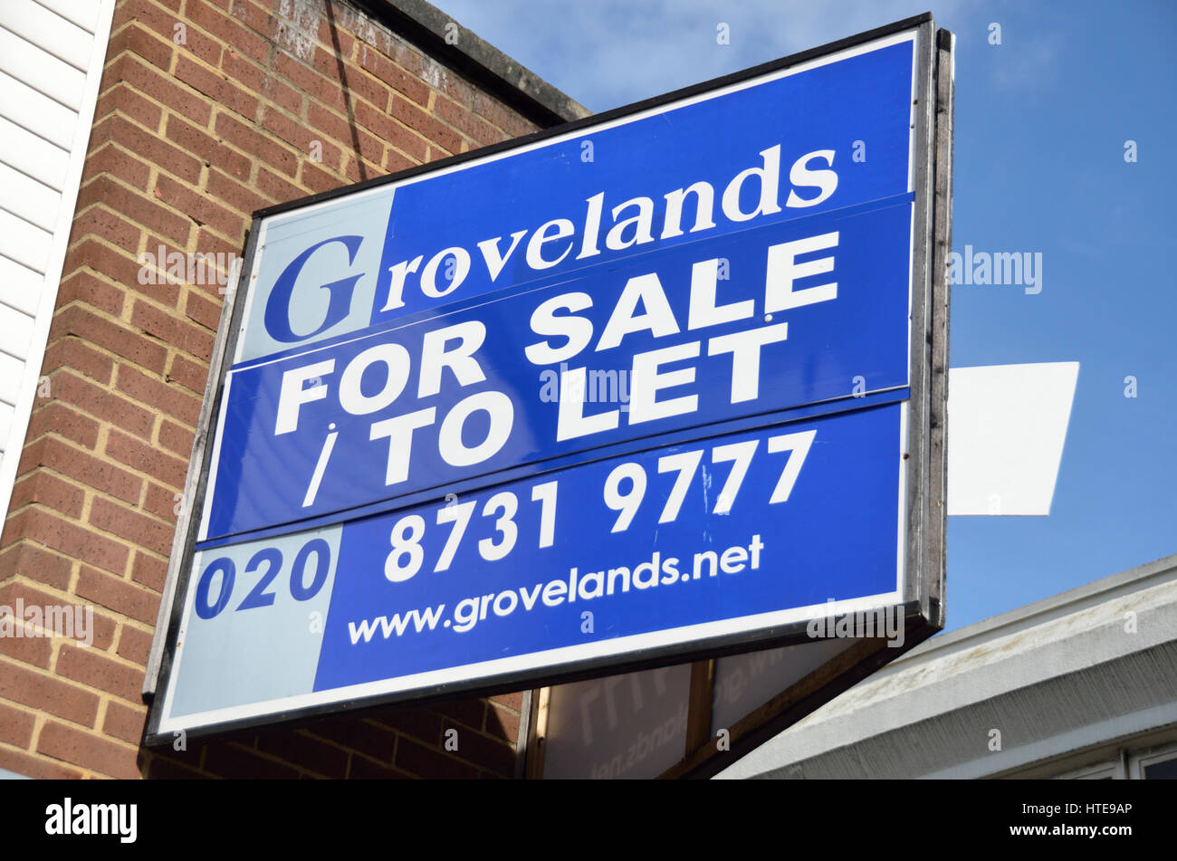 Commercial 'For Sale/To Let' estate agent board. - Stock Image
