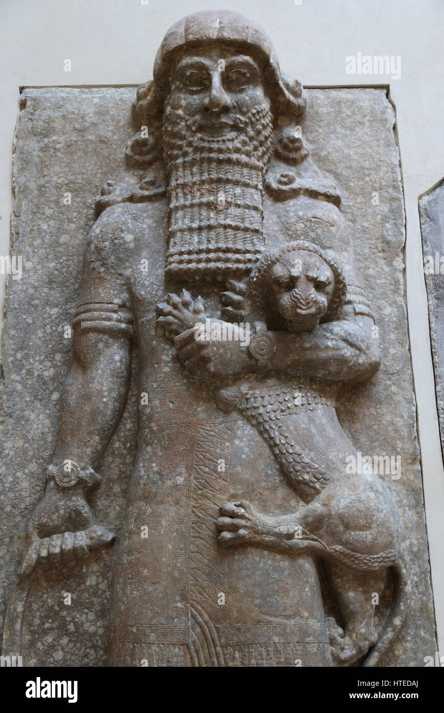 The hero overpowering a lion (identified with Gilgamesh). Palace of Sargon II. Assyrians.  Throne room. Assyrians. - Stock Image