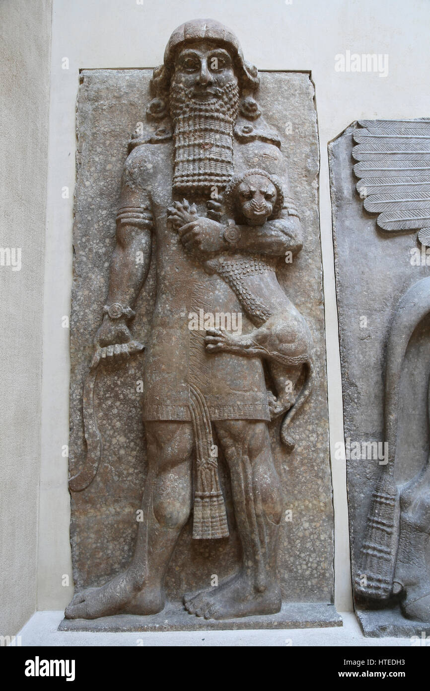 Hero overpowering a lion (identified with Gilgamesh). Palace of Sargon II. Assyrians.  Throne room. Assyrians. 721 - Stock Image