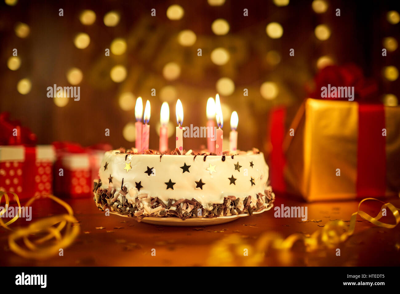 Happy Birthday Cake With Candles On The Background Of Garlands And